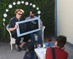 A cute DIY photo booth with a chalkboard to write messages to us.