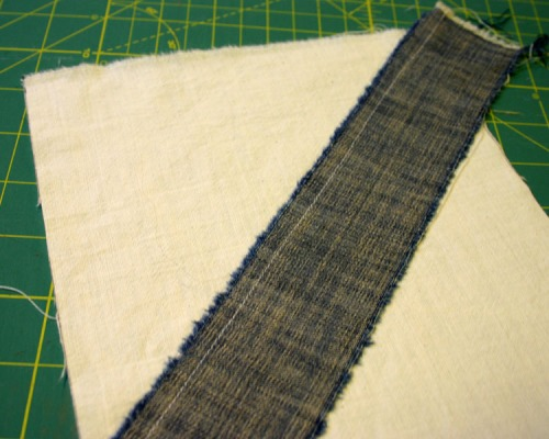 Mark 12 unbleached cotton rectangles with a line from the top right corner to halfway down the left side.  Dp the same for the other 12 rectangles, but reversing the direction.  The line acts as a guide for stitching your first strip down.