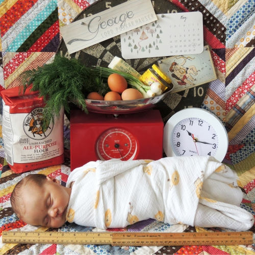 George's stats: Name, birth date (on the calendar), Gemini, weight (5lb. sack of flour plus 2 lbs. 14 oz. on the scale), time, and length (the ruler).