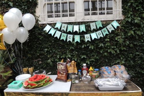 I repeat...SIMPLE...Here is the BBQ table, with a banner, some balloons and a gold fringe table skirt.