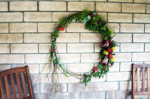 I made one giant floral and grapevine wreath to anchor the back wall of the outdoor space.