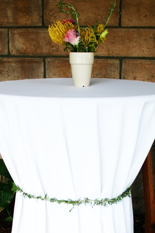 I tied each table skirt loosely with rosemary garlands instead of ribbon to keep them tidy and neat.
