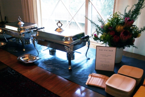 After the ceremony, we had a pot pie bar set up inside. The guests picked a filling and then topped it with crispy puff pastry squares. We used bamboo plates and forks throughout the whole party since there wasn't a sit down dinner. The bamboo elevates disposable plates and forks to something a little more elegant.