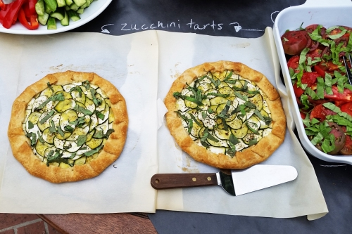 I laid the zucchini tarts out on the parchment paper they were baked on to keep it casual.