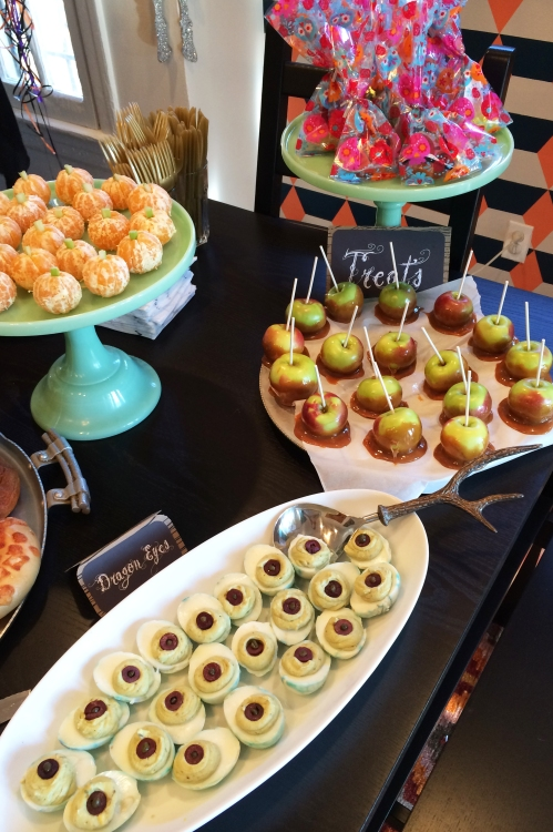 We added avocado to deviled eggs to give them a dragon-y green tinge and olives for pupils.  Peeled mandarins with a bit of celery look just like little pumpkins and half dipped caramel lady apples are easier on small mouths and bellies.