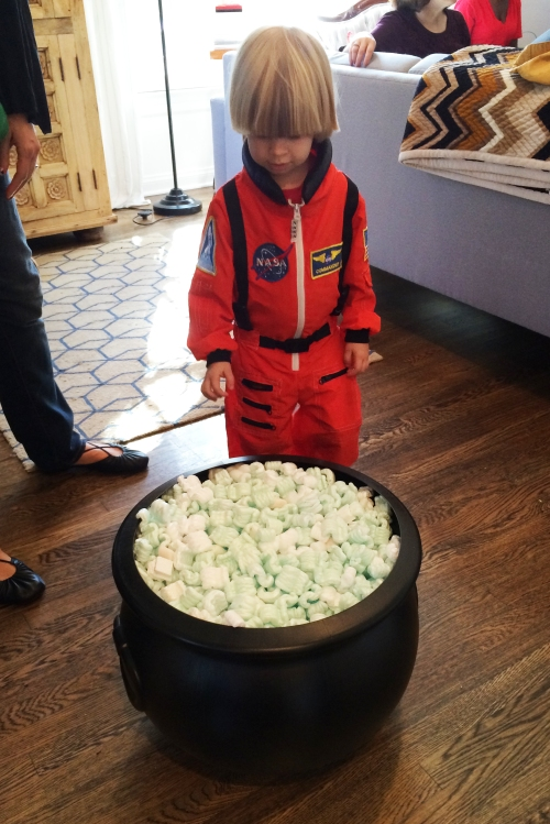 My co-hostess brought this brilliant Halloween game for little kids.  Fill a plastic cauldron with little treats and green packing peanuts and then let the kids go crazy trying to grab the stuff in there!