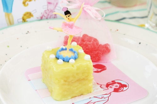 Lemon petit four with vintage plastic ballerina.