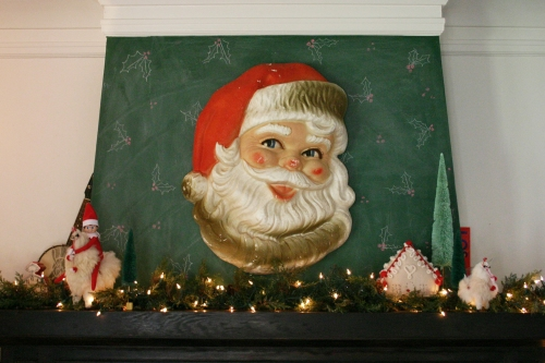 This wonderful/slightly creepy vintage foam Santa head is one of my prized possessions!  I paired it this year with a wool gingerbread house, bottle brush trees and some fat llamas.