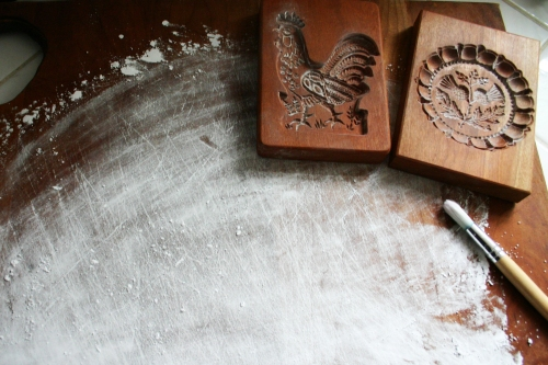 Coat your surface with confectioners sugar as well so the dough doesn't stick when you roll it out.
