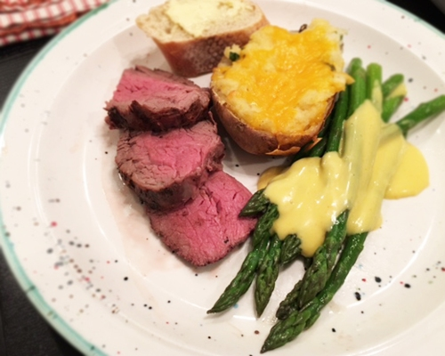 Christmas Eve feast...roast beast, asparagus with hollandaise, and twice baked potatoes!