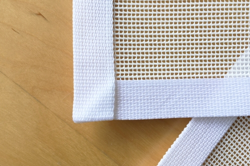 I mitered the webbing on the bottom corners so I could simply continue sewing instead of cutting three separate lengths.