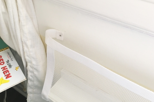 Use the velcro to stick the bottom edge of the mesh onto the front of the shelf and then turn in the long ends and secure to the wall. I used small nails because we live in a rental, but you could use a screw or do something more decorative.