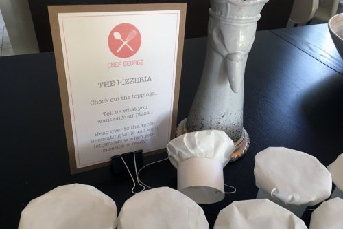 When guests entered, they gave their pizza order to me or my mom and then headed outside.   I made tiny party sized chef hats out of butcher paper and copy paper!